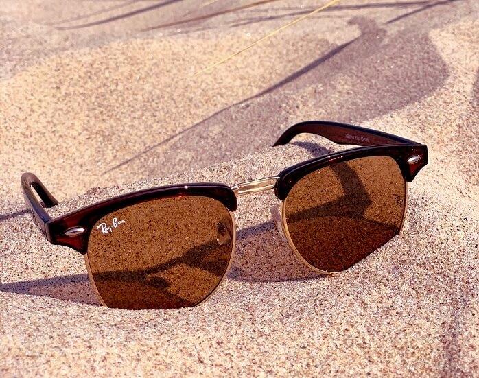 A sunglass on the sand